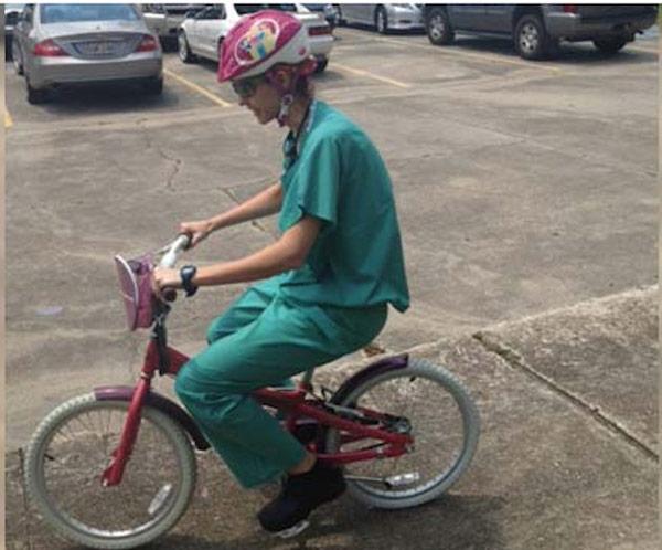 Breast Cancer Surgeon Rides Child S Pink Bike To Get