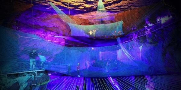 Huge underground trampoline park in a cavern