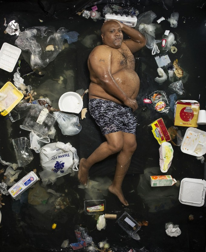 Portraits of people in 7 days' worth of their own garbage