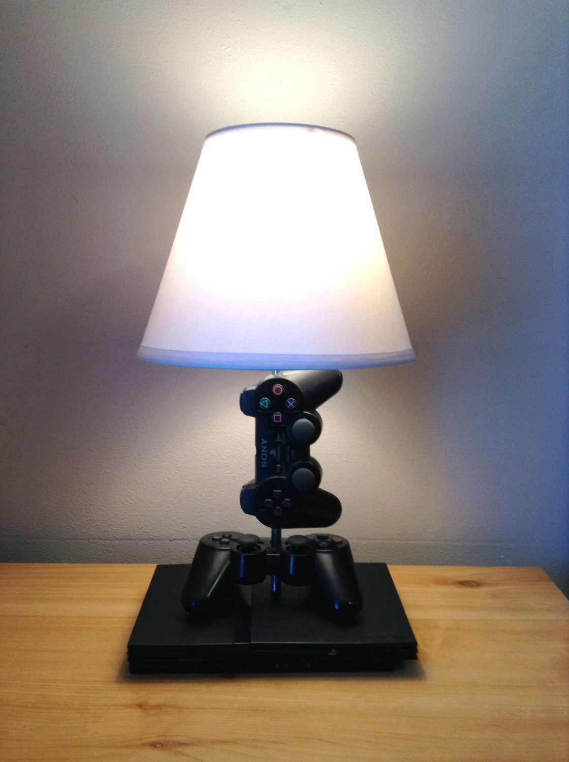 Lamps made from old game consoles, controllers and