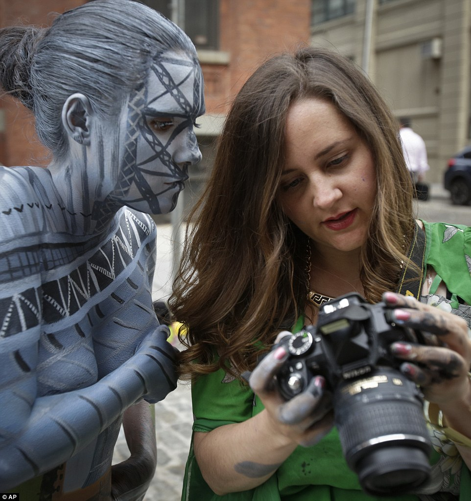 Bodypainted models blend perfectly into New York City