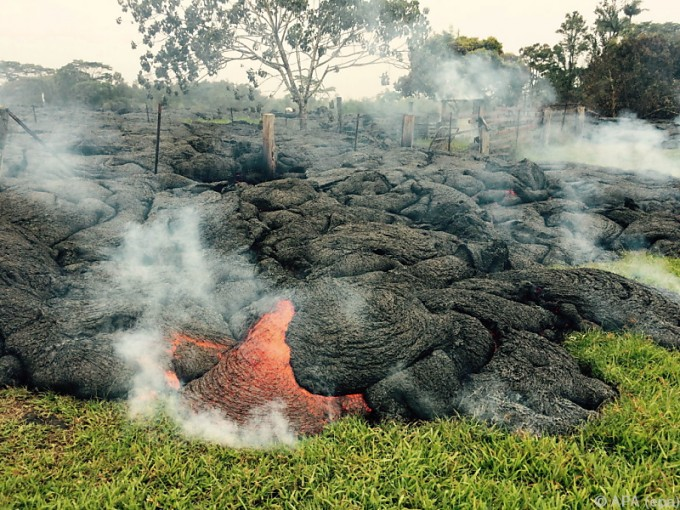 The lava flow from the Kilauea Volcano is seen in a U.S. Geological Survey (USGS) image taken near the village of Pahoa, Hawaii, at 10:00HST (20:00GMT) October 26, 2014.