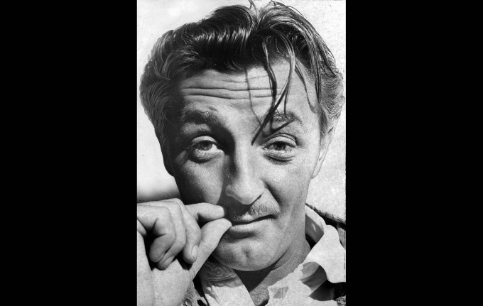 Back in jail after a sojourn at the county honor farm, actor Robert Mitchum strokes a new mustache. This photo was published in the March 25, 1949 Los Angeles Times.