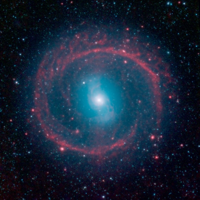 Galactic Wheel of Life shines in new infrared space image from NASA Spitzer telescope