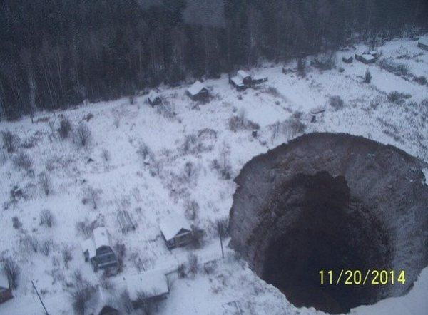 Photo of  a monstrous hole swallowing a neighborhood