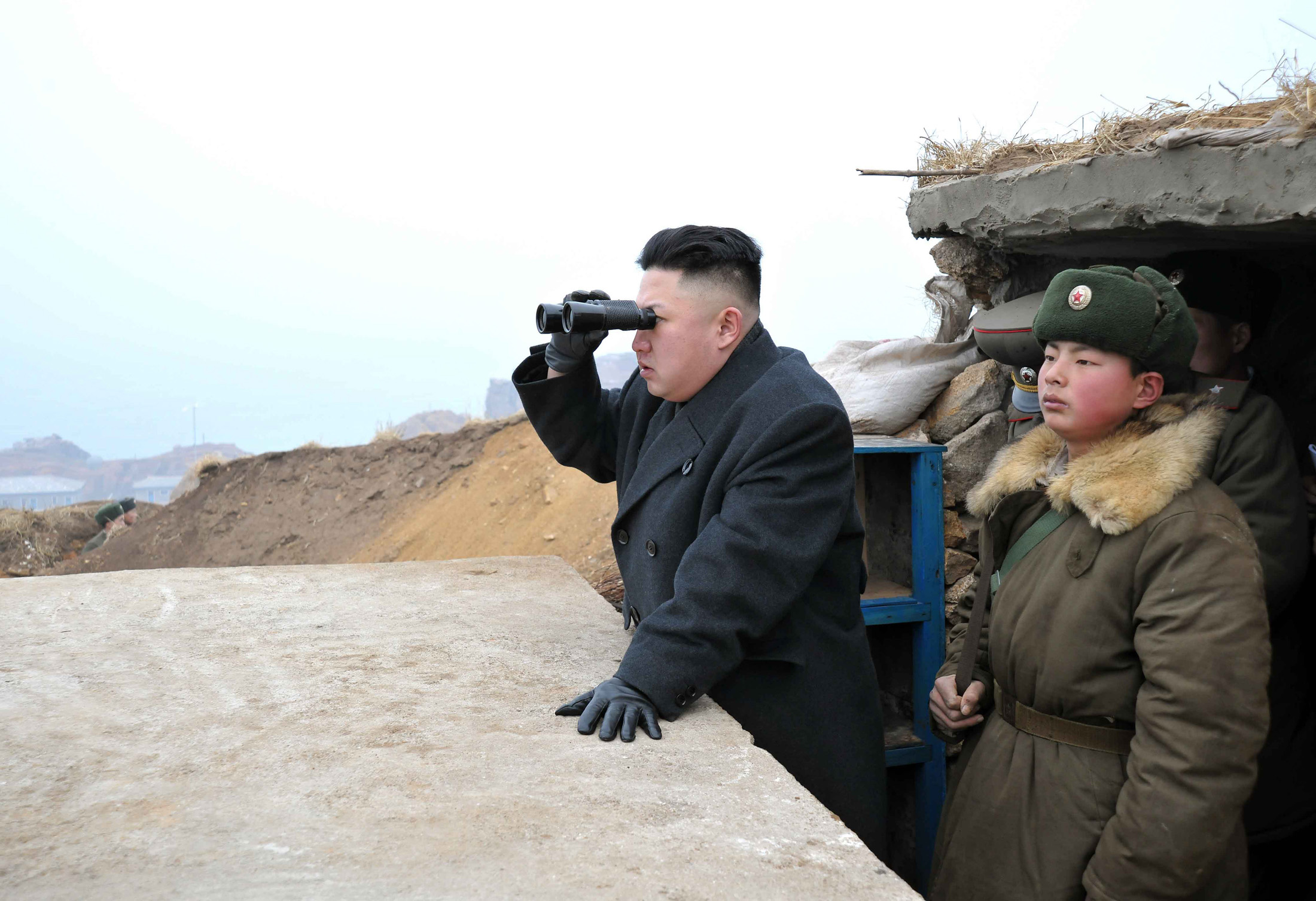 North Korean leader Kim Jong-Un looks over the border with South Korea,  March 7, 2013.