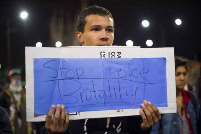 Bryan McKetney joins more than 100 protesters against police violence in Berkeley, California December 10, 2014. REUTERS/Noah Berger
