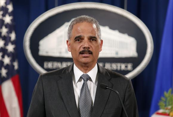 U.S. Attorney General Eric Holder makes a statement about the grand jury decision not to seek an indictment in the Staten Island death of Eric Garner during an arrest in July, in Washington December 3, 2014. [Reuters]