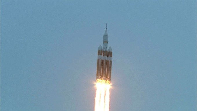Dec. 5, 2014 -- A Delta IV Heavy rocket lifts off from Space Launch Complex 37 at Cape Canaveral Air Force Station in Florida carrying NASA's Orion spacecraft on an unpiloted flight test to Earth orbit. Liftoff was at 7:05 a.m. EST. During the two-orbit, four-and-a-half hour mission, engineers will evaluate the systems critical to crew safety, the launch abort system, the heat shield and the parachute system. Photo: NASA