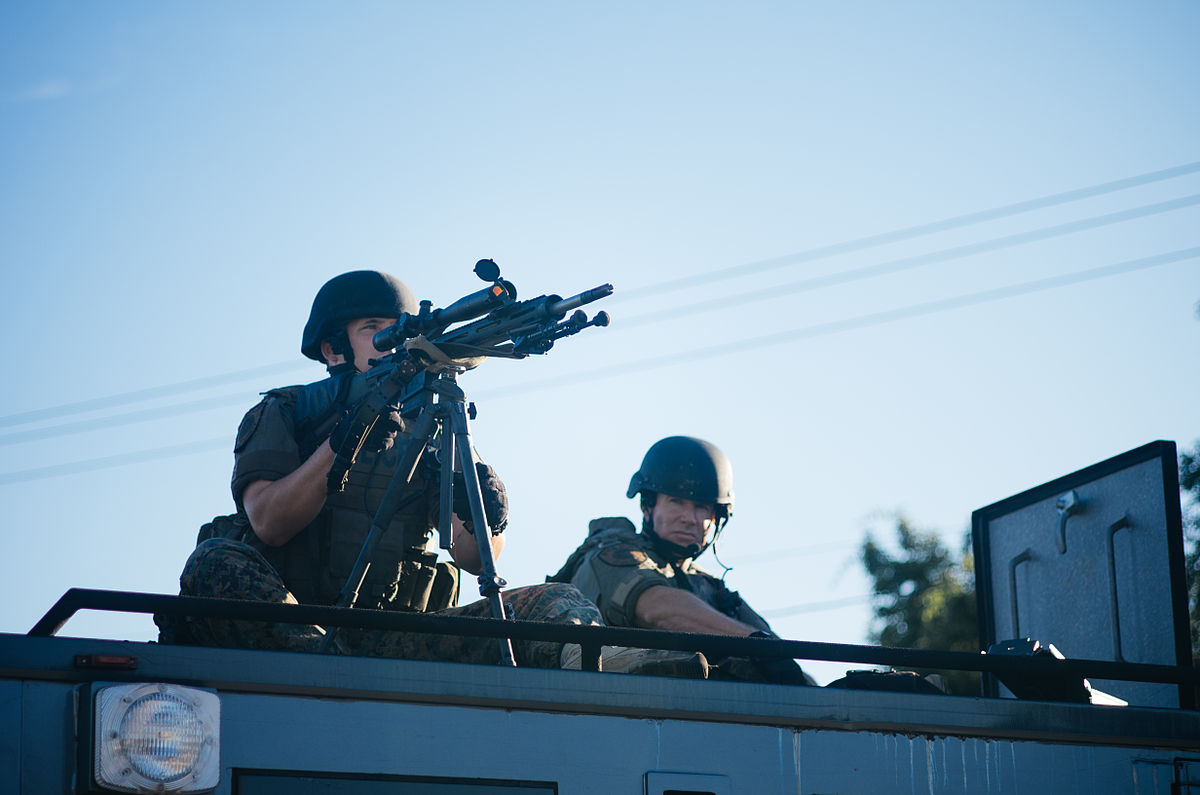 1200px-Police_sharpshooter_at_Ferguson_protests