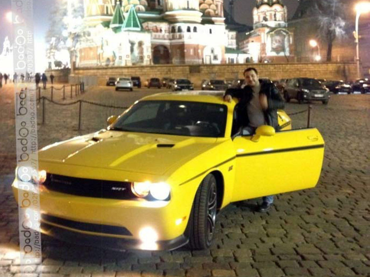 Roman Seleznev and his Dodge Challenger SR in front of the Kremlin in Moscow. The photo was found on his mobile phone.