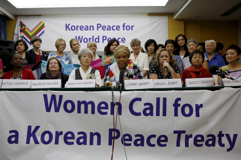 Members of the WomenCrossDMZ group attend a news conference before they leave for North Korea's capital Pyongyang, at a hotel in Beijing, China, May 19, 2015. REUTERS/Kim Kyung-Hoon