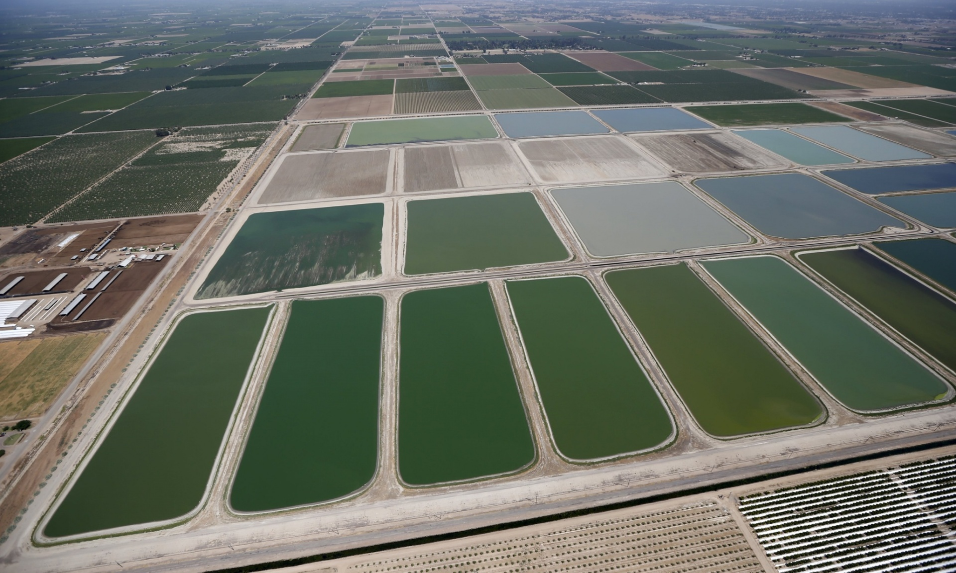Fresno-Clovis Regional Wastewater Treatment Facility is seen next to farm fields in Fresno [Reuters]