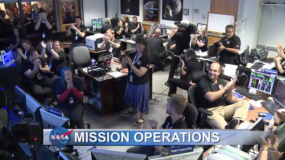Cheers and clapping at the Mission Operations Center (MOC), where the New Horizons spacecraft signal was received.