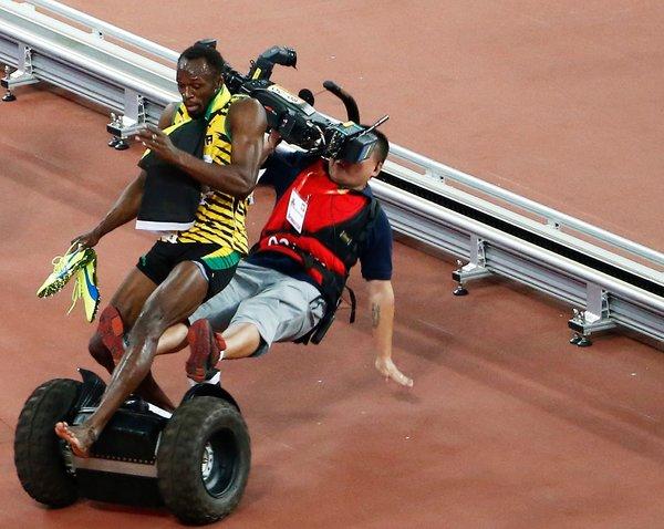 Watch Usain Bolt Get Run Over By A Photographer On A