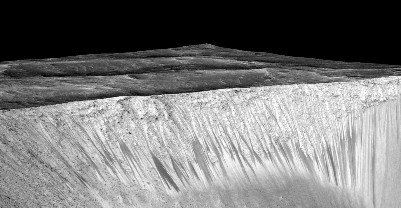 Dark narrow streaks called recurring slope lineae emanate from the walls of Garni crater on Mars. [NASA]