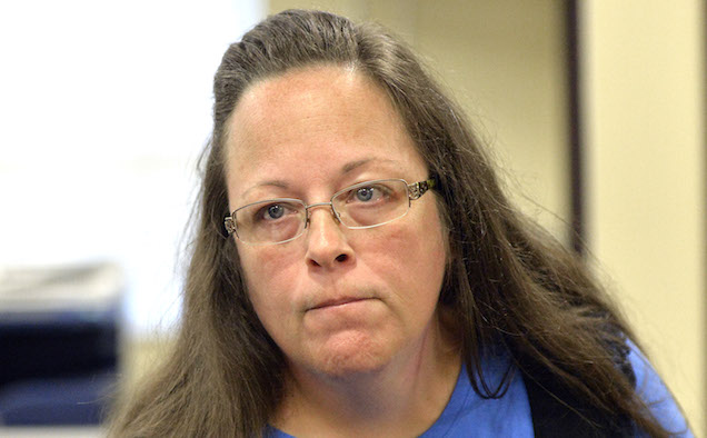 Kim Davis listens to a customer following her office's refusal to issue marriage licenses.
