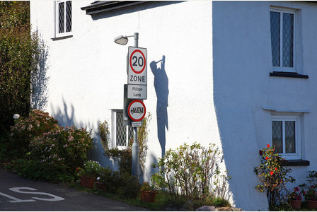 Freaky! Street sign casts shadow of hanging man