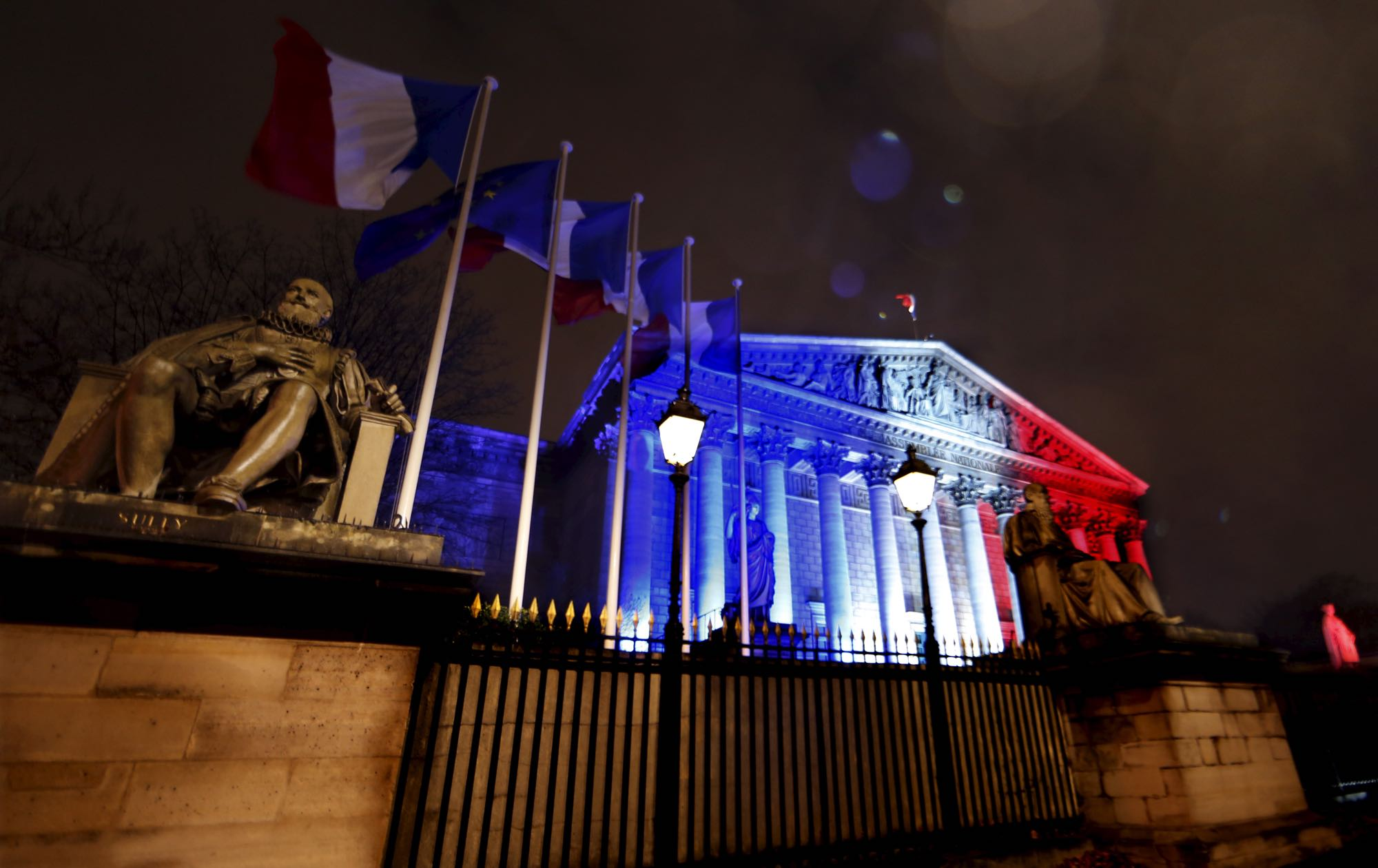 France's National Assembly  lit with the colors of the French flag in Paris, Nov. 19, 2015, to honor victims of terrorist attacks. [Reuters]