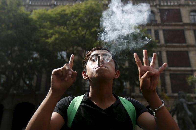 A man gestures in support of pot legalization outside the Supreme Court in Mexico City, Nov. 4, 2015.  REUTERS