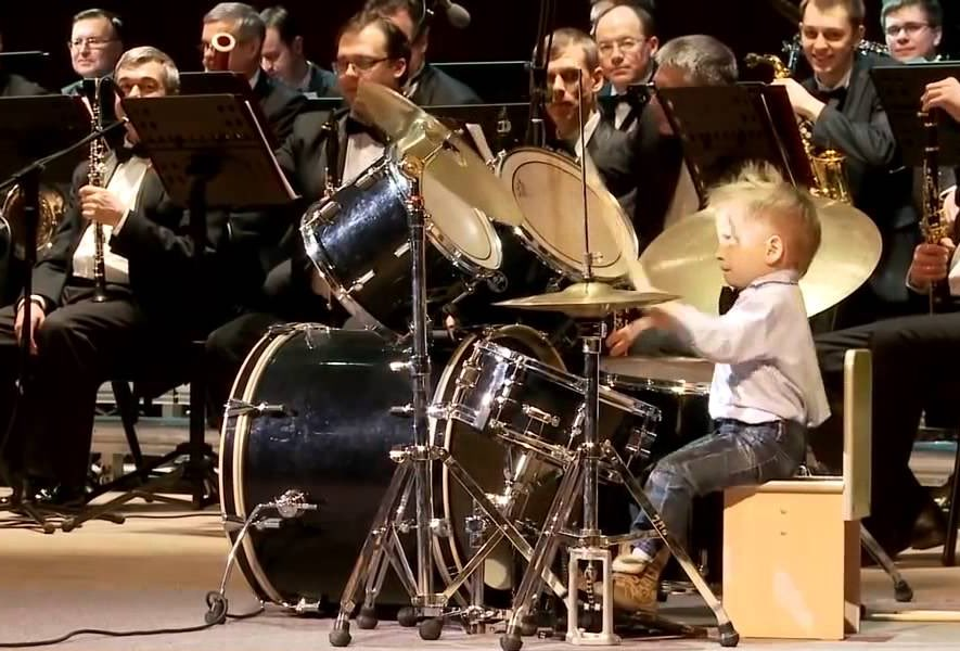 Drummer, 3, leads orchestra in the most badass way possible