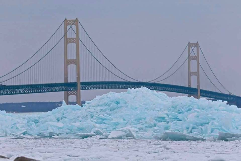 Gorgeous photos show blue colored ice stacks on Great Lakes in Mackinaw City, MI