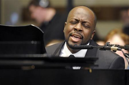 Wyclef Jean sings at the funeral mass for Sargent Shriver, 2011. REUTERS
