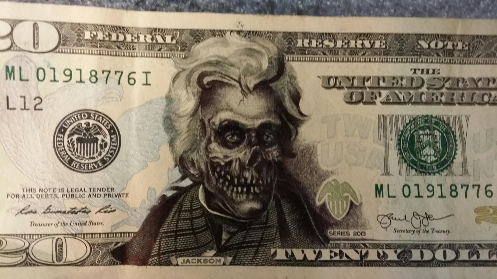 Skull drawn over Andrew Jackson on $20 bill