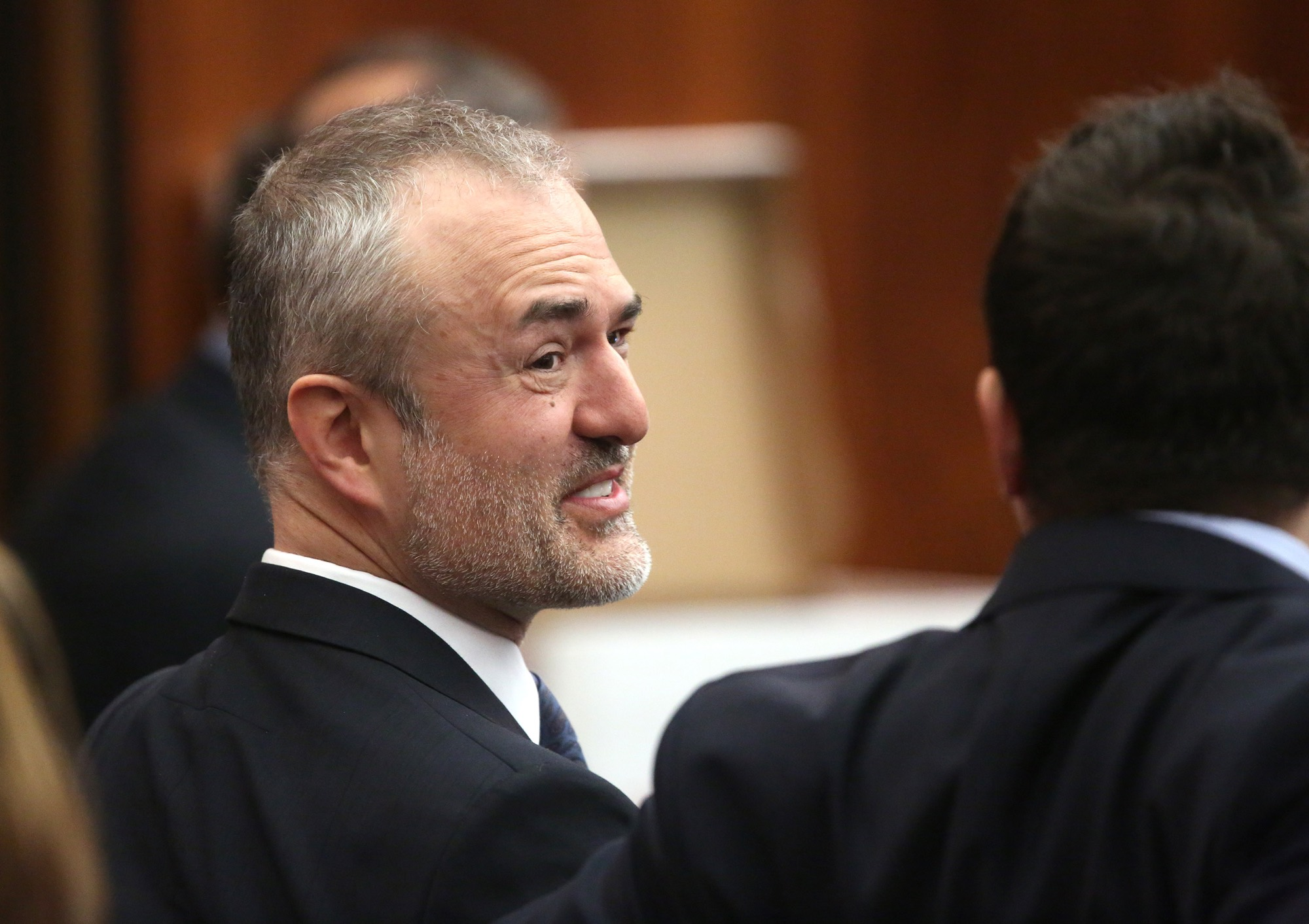 Gawker founder Nick Denton talks with his legal team before Hulk Hogan testifies in Florida court, March 8, 2016.