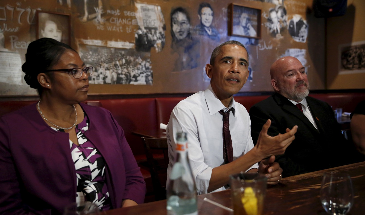 Obama with formerly incarcerated individuals who received commutations from his and previous administrations. March 30, 2016, DC.  With him, former inmates Romana Brant (L) and Phillip Emmert. REUTERS