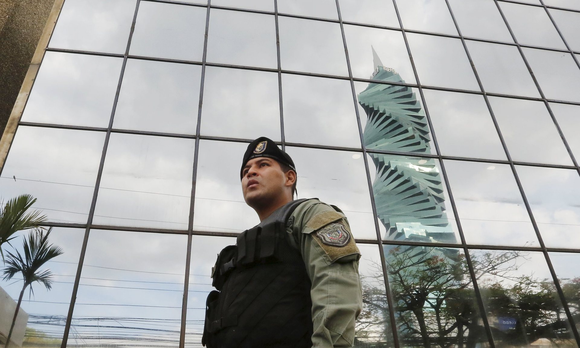 Guard outside the offices of Mossack Fonseca, in Panama. [Reuters]