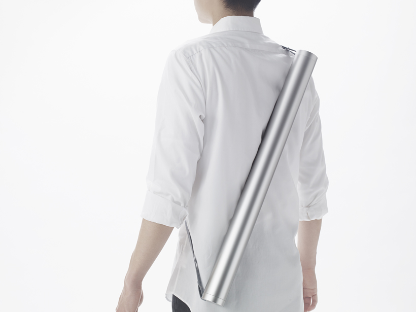 "Beautiful Japanese ""minimalist survival kit"" that fits in a tube you wear on your back"