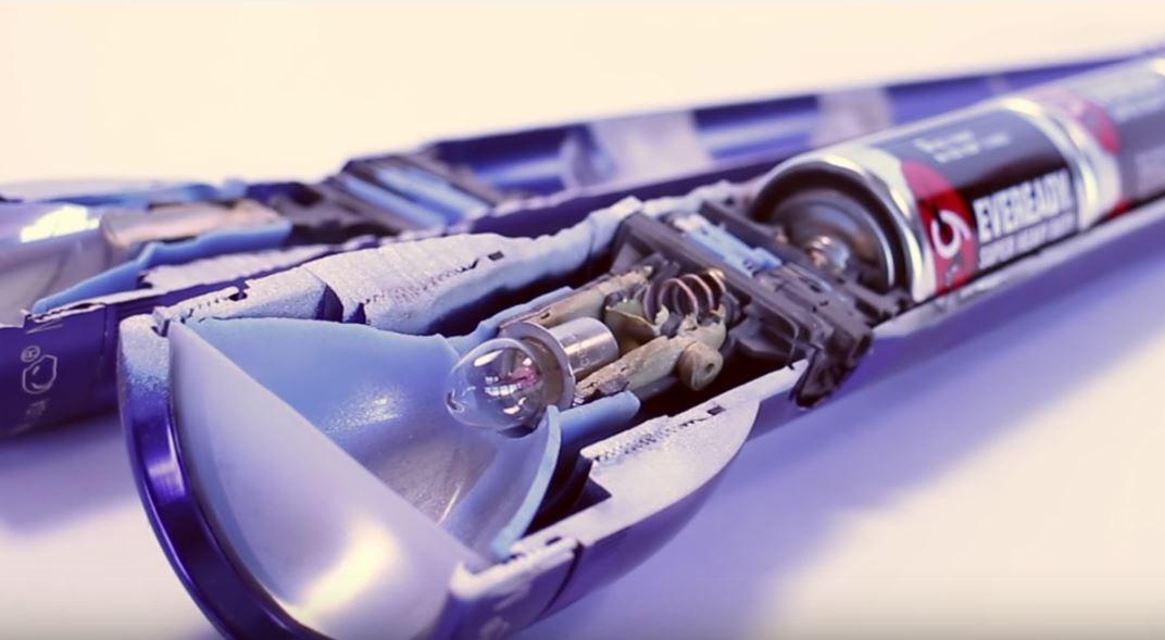Watch a 60,000 psi water jet cut gadgets in half