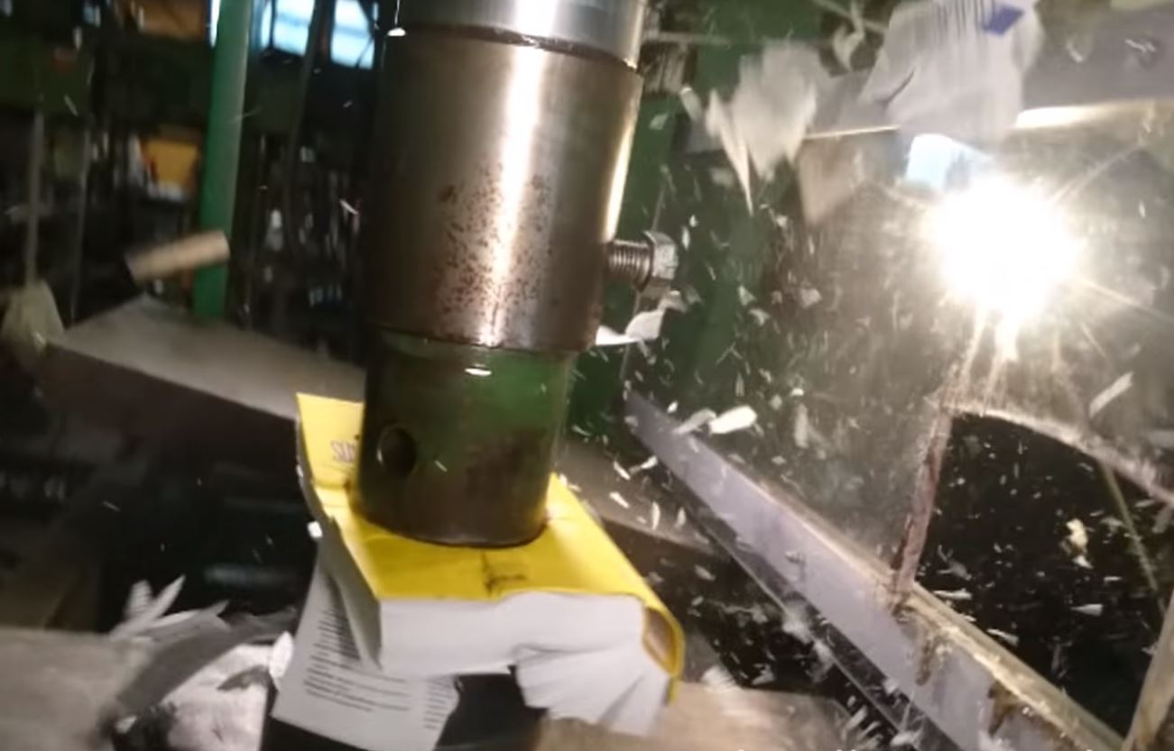 Attempt to crush book with hydraulic press goes awry