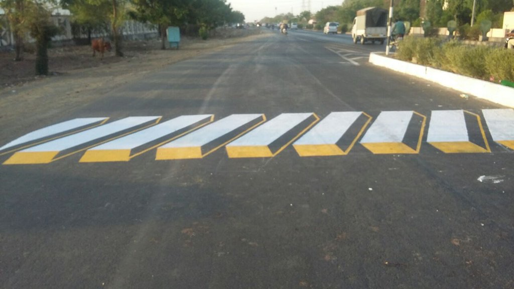 Indian trying out optical illusion speed bumps
