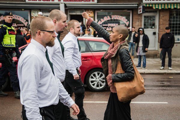 One woman defies neo-Nazi marchers in striking portrait from racist march in Sweden
