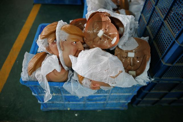 Masks of U.S. Republican presidential candidate Donald Trump lie in a box at Jinhua Partytime Latex Art and Crafts Factory in Jinhua, Zhejiang Province, China, May 25, 2016.  REUTERS/Aly Song