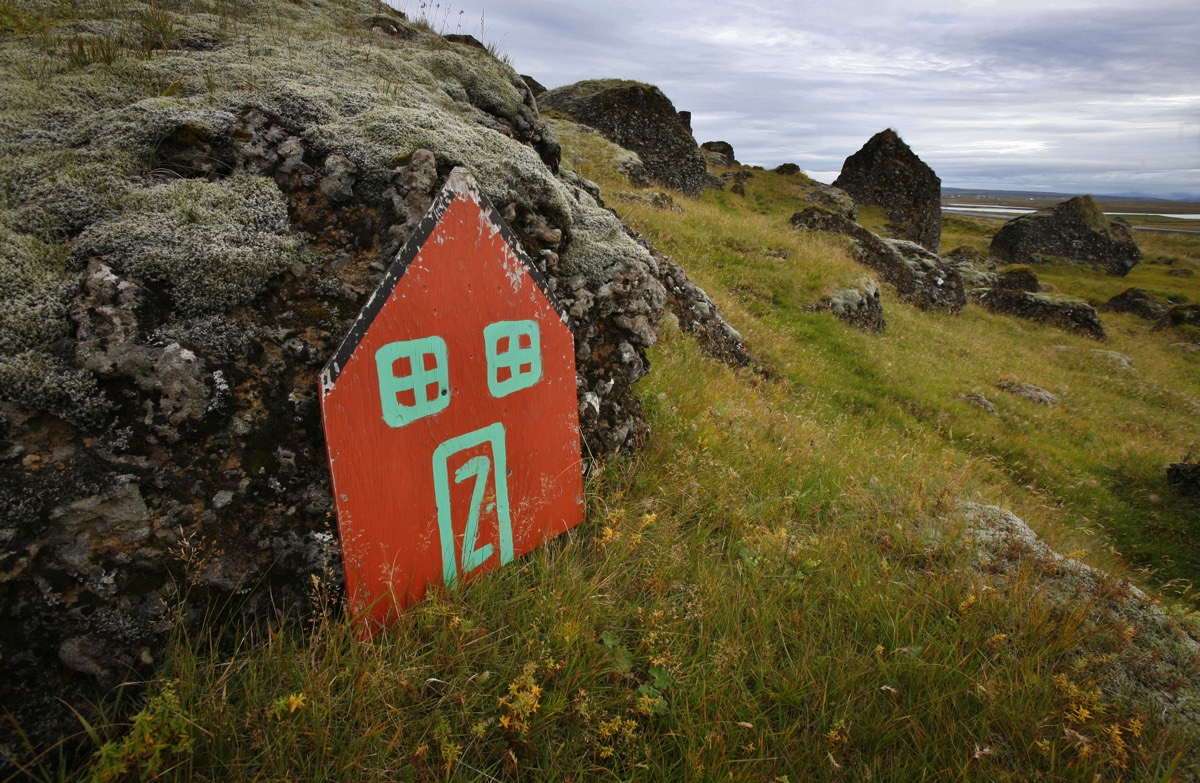 An elf door leans against a rock in the Icelandic countryside outside the village of Selfoss October 1, 2006. Belief in the unseen runs so high in Iceland that the Public Roads Administration sometimes delays or reroutes road construction to avoid what locals believe are elf habitat. 2006. REUTERS