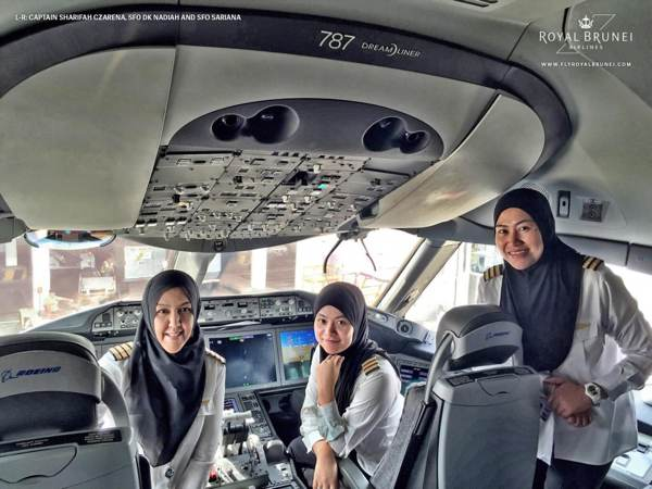Captain Sharifah Czarena Surainy Syed Hashim, Senior First Officer Dk Nadiah Pg Khashiem and Senior First Officer Sariana Nordin in the cockpit of  a Boeing 787 Dreamliner