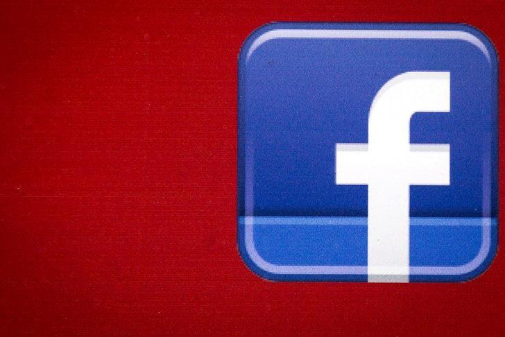 A Facebook logo is displayed on the side of a tour bus in New York, 2015. REUTERS
