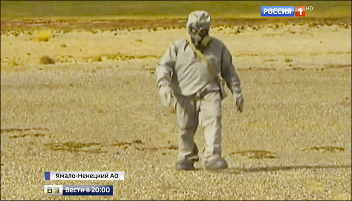 Russian biowarfare troops  incinerating potentially infected reindeer carcasses at high temperatures. Image: Vesti, from the Yamal Region in Russia.