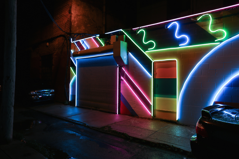 Neon street mural transforms seedy south philly side for Mural lighting