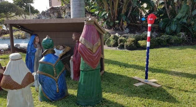 Florida atheists pair public nativity scene with a combustible Trump-themed Distrestivus pole