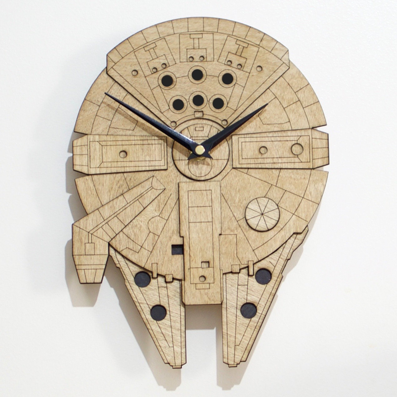 Laser-cut, wall-mounted Millennium Falcon clock / Boing Boing