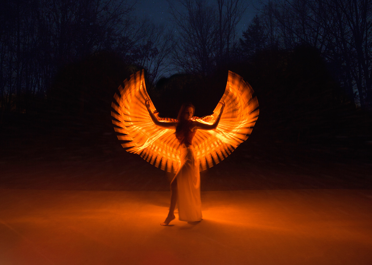 How a photographer creates fire-winged portraits