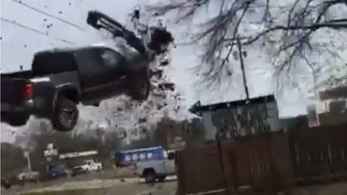 Pickup truck going 115mph avoids road block by flying through the air