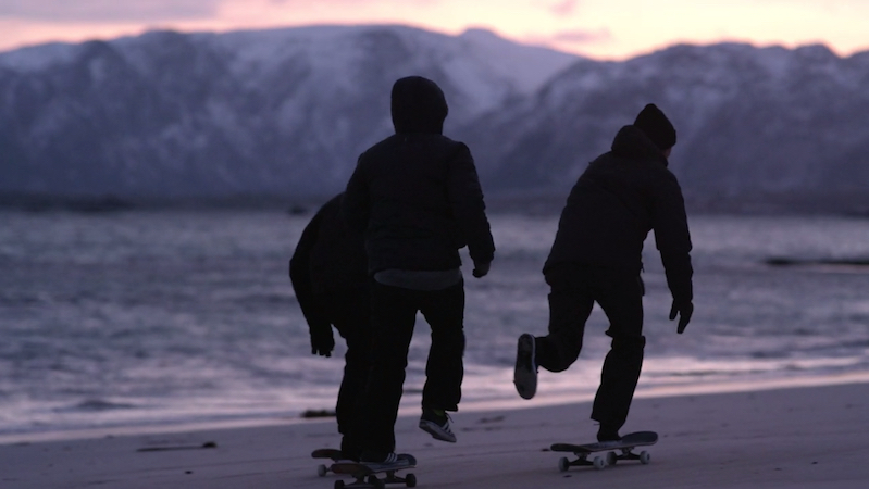 Watch skateboarders skate on frozen sand