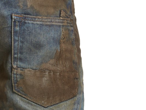 Imagine you work by paying $425 for artificially mud-stained jeans