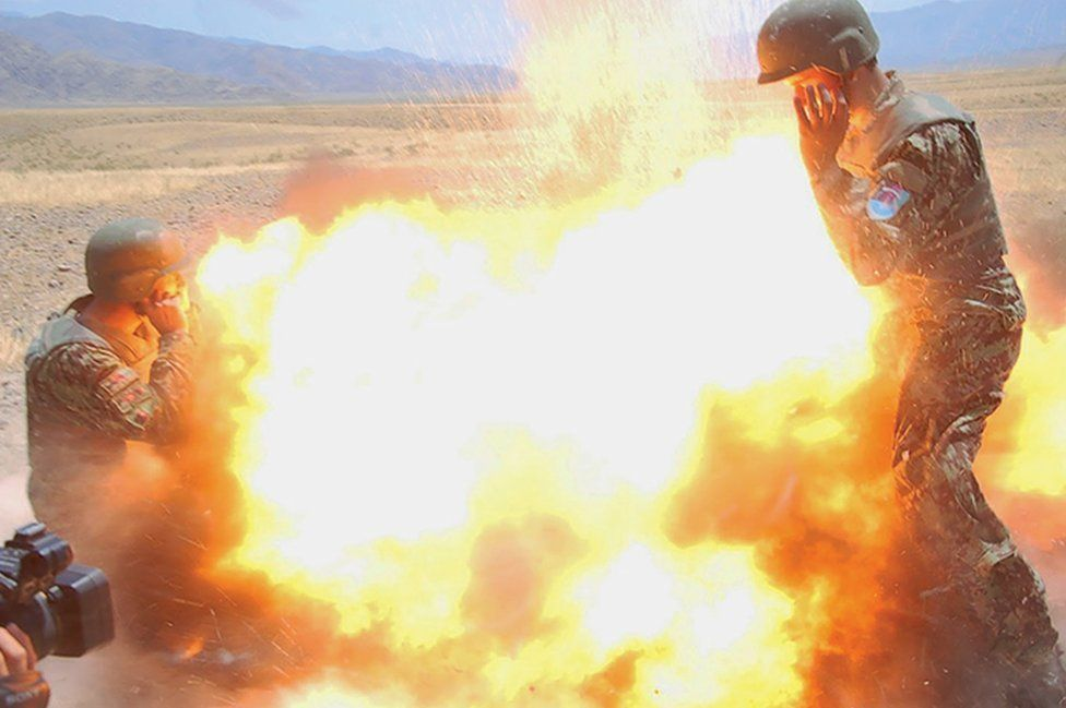 Photographers captured shots of mortar exploding in the instant before their deaths