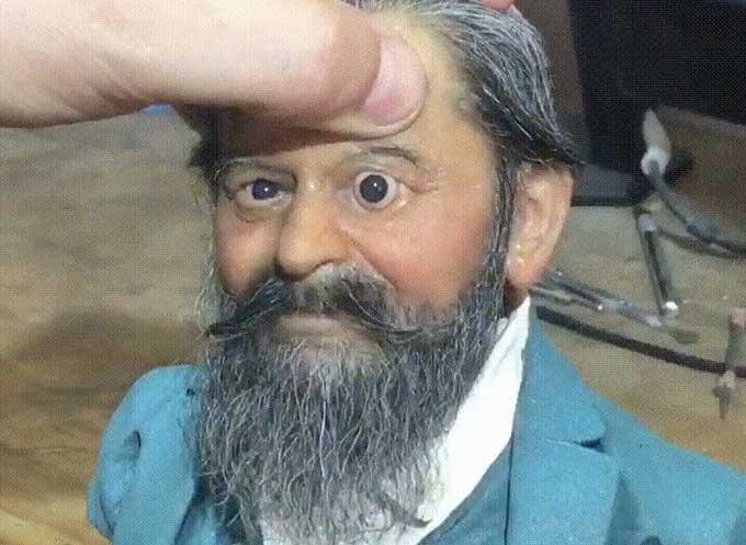 Sculptor pops eye into super realist model of a man